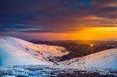 Winter landscape with a sunset. Ukraine, the Carpathian mountains.