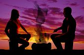 Silhouette Man And Woman Roasting Marshmallows