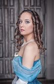 stock photo of pompous  - Portrait of young beautiful medieval woman in blue dress - JPG
