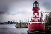 light house on a red ship in the harbor