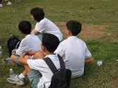 Asian Students In School Uniform Listening Attentively