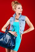 A photo of beautiful girl is in fashion style on  red  background, glamour