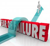 Fear of Failure words in red 3d letters and a man jumping over it to overcome a challenge such as an