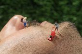 Miniature Life People Mowing Hair off a Mans Face