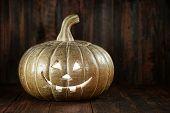 Pumpkin Jack O Lantern on Wood Grunge Rustic Background