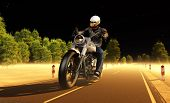 Rider moves along the road at night.