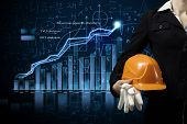 Close up of businesswoman with yellow hardhat in hand
