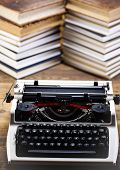 d retro typewriter on old book