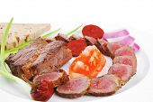meat food : bbq meat served on white plate with tomatoes , sprouts and bread isolated on white backg