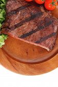 fresh beef steak grilled barbecue fillet on wooden dish with vegetable green salad and cherry tomato