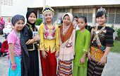 Smiling children of Malaysia in multi-racial costumes