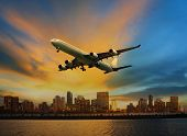 image of air transport  - passenger plane flying above urban scene use for convenience air transport and logistic cargo by air transportation - JPG