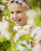 Beautiful girl playing in the rose garden