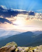 majestic Sunrise over the mountains  with sunbeams, Ukraine, Carpathians, Europe