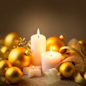 Christmas Golden Candles Background with Baubles and Ribbons