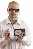 Doctor holding hard disk and stethoscope over white background