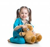 picture of auscultation  - Adorable child with clothes of doctor examining teddy bear toy over white - JPG