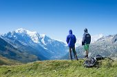 COL DE BALME, FRANCE - SEPTEMBER 01: Backpackers looking at view with Mont Blanc in the background.