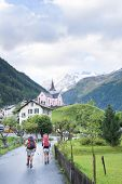 TRIENT, SWITZERLAND - SEPTEMBER 01: Backpackers approaching Trient, with Fontanabran mountain in the
