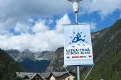 TRIENT, SWITZERLAND - AUGUST 31: Ultra Trail du Mont Blanc banner and Fontanabran mountain in the background. The ultra-marathon takes on average 30 to 45 hours to complete. August 31, 2014 in Trient.