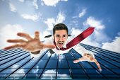 Businessman falling down from a building