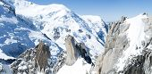 Panoramic composite of Mont Blanc mountain range, In Chamonix, France, with climbers on its rocks
