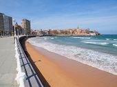 Looking Along San Lorenzo's Beach Towards The Peninsula Of Santa Catalina At Gijon In Asturias, Spai