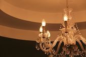 Luxury Crystal Chandelier On Dark Wall Background