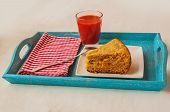 Portion Of Oat Flour Cake And Mug  Of Tomato Juice On A Tray