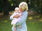 Happy Grandmother Holding Cute Baby