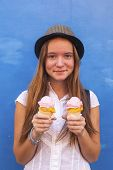 Young cute hipster girl with ice cream in hand.