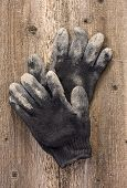 A Pair Of Work Gloves On The Old Wooden Background