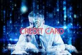 The word credit card and mature businessman examining with magnifying glass against lines of blue bl