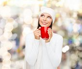 happiness, winter holidays, christmas, beverages and people concept - smiling young woman in white w
