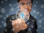 business, technology, internet and social networking concept - businessman pressing button with cont