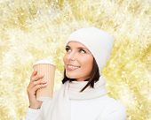 happiness, winter holidays, christmas, beverages and people concept - smiling young woman in white h