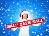 sale, shopping, christmas, holidays and people concept - smiling woman in santa helper hat with red