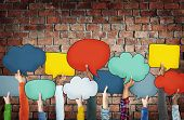 Group of Diverse Hands Holding Colorful Speech Bubbles