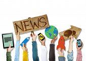Diverse Hands Holding News Symbols