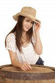 Cowgirl Tan Hat Behind Barrel Smile Hand On Hat