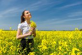 woman in yellow flower field