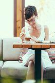 Young beautiful woman enjoying in coffee shop