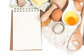 Recipe Book And Baking Ingredients Eggs, Flour, Sugar, Butter, Yeast.