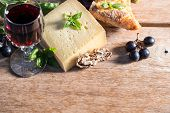 Cheese With Red Wine, Walnuts, Basil Leaves And Grapes