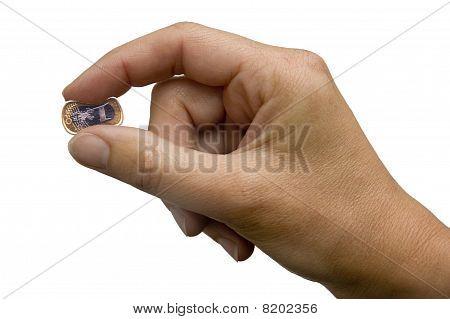 Hand Pinching a Euro