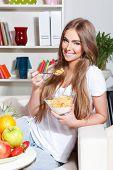 Happy Woman Eating Healthy Breakfast