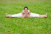 image of straddling  - Beautiful woman practicing yoga in the park.Wide-Angle Seated /