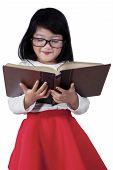 Lovely Schoolgirl Reading A Book In Studio