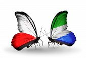 Two Butterflies With Flags On Wings As Symbol Of Relations Poland And Sierra Leone