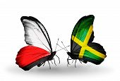 Two Butterflies With Flags On Wings As Symbol Of Relations Poland And Jamaica